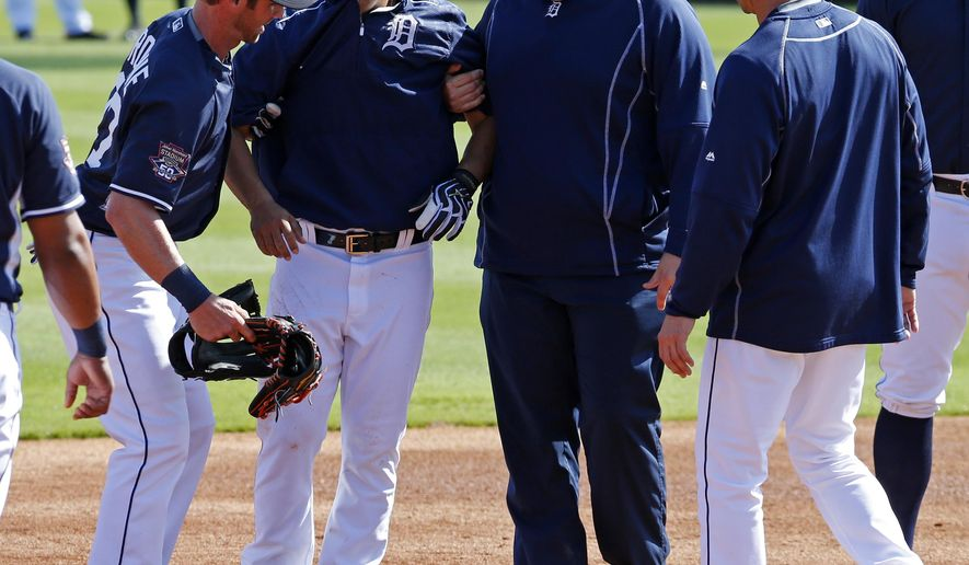 Detroit Tigers' Jose Iglesias, second from left, is helped by Andrew Romine, left, and a team trainer as manager Brad Ausmus, right, looks on after Iglesias was hit on the right leg by a ball hit by J.D. Martinez during batting practice before a spring training exhibition baseball game against the Houston Astros in Lakeland, Fla., Sunday, March 8, 2015. Iglesias was helped from the field.  (AP Photo/Gene J. Puskar)