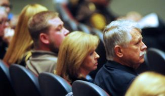 The Mueller family is seen during the memorial service for Kayla Mueller in the Yavapai College Performance Hall Saturday, March 7, 2015 in Prescott, Ariz. (AP Photo/The Daily Courier, Les Stukenberg)