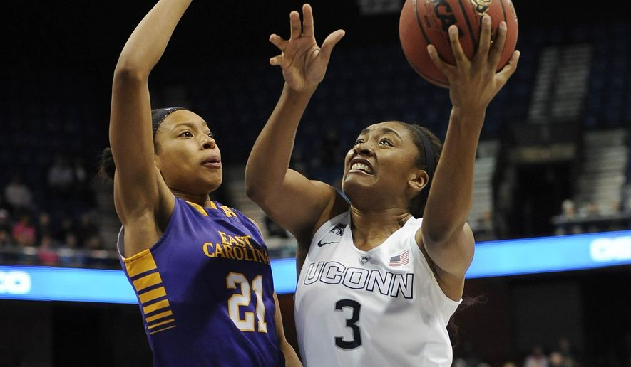 Connecticut's Morgan Tuck, right, shoots as East Carolina's Abria Trice defends, during the first half of an NCAA college basketball game in the semifinals of the American Athletic Conference tournament, Sunday, March 8, 2015, in Uncasville, Conn. (AP Photo/Jessica Hill)