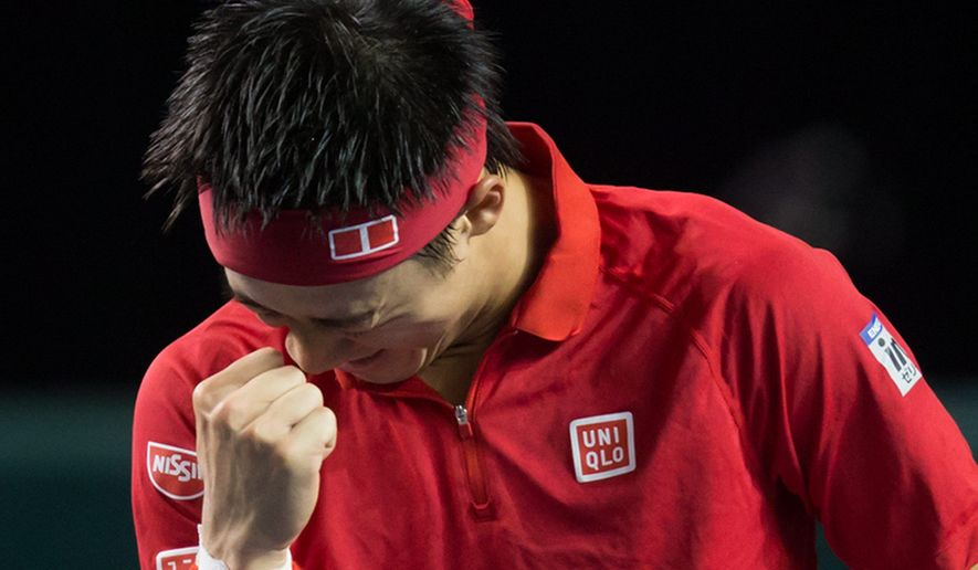 Japan's Kei Nishikori celebrates after defeating Canada's Milos Raonic during a Davis Cup tennis World Group first-round singles match in Vancouver, British Columbia, Sunday, March 8, 2015. (AP Photo/The Canadian Press, Darryl Dyck)