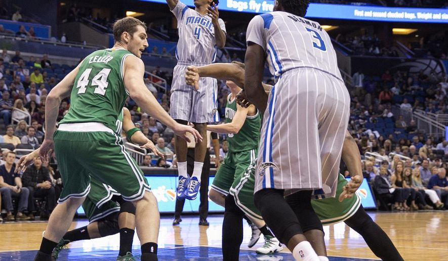 Orlando Magic guard Elfrid Payton (4) shoots near Boston Celtics center Tyler Zeller (44) during the first half of an NBA basketball game Sunday, March 8, 2015, in Orlando, Fla. (AP Photo/Willie J. Allen Jr.)