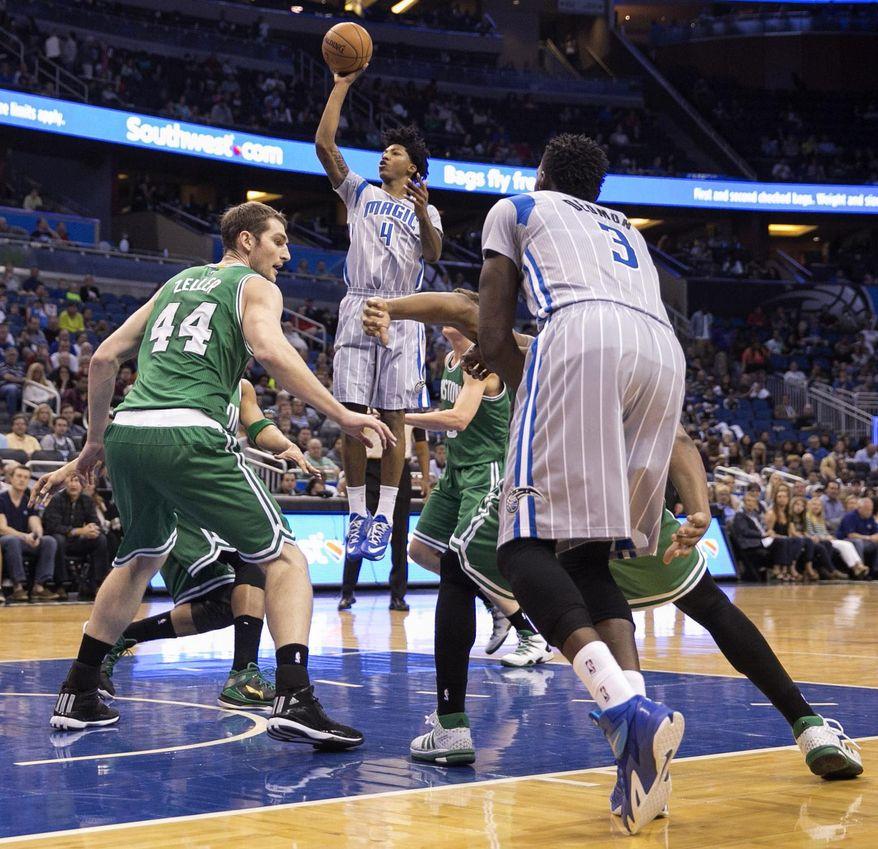 Orlando Magic guard Elfrid Payton (4) shoots near Boston Celtics center Tyler Zeller (44) during the first half of an NBA basketball game Sunday, March 8, 2015, in Orlando, Fla. (AP Photo/Willie J. Allen Jr.)