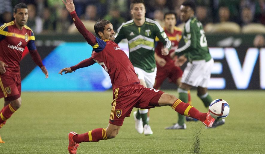 Sebastian Jaime, of Real Salt Lake, stretches for the ball against the Portland Timbers during the first half of an MLS soccer game, Saturday, March 7, 2015, in Portland, Ore. (AP Photo/Troy Wayrynen)
