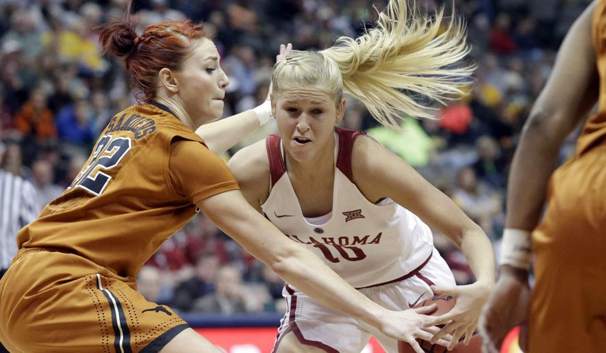 Oklahoma guard Peyton Little (10) drives against Texas guard Brady Sanders (32)  during the first half of an NCAA college basketball game in the semifinal round of the Big 12 Conference tournament Sunday, March 8, 2015, in Dallas. (AP Photo/LM Otero)