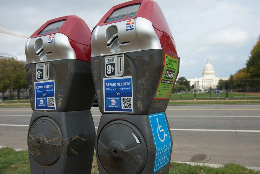 The Accessible Parking Amendment Act of 2012 would involve creating some 1,800 red-top meters such as this that are specifically designated for the disabled, but the devices were installed in such a haphazard manner that incoming transportation officials plan to remove a slew of them before advancing the program. (The Washington Times)