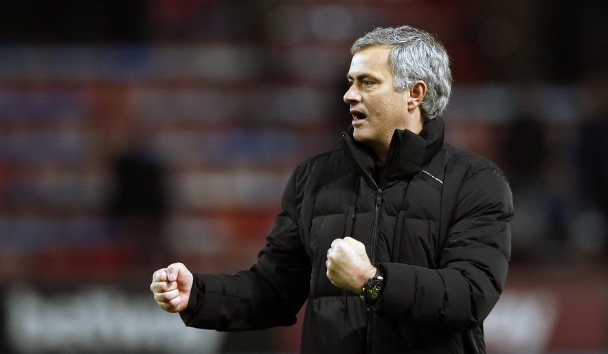 Chelsea's head coach Jose Mourinho celebrates towards his teams fans after the English Premier League soccer match between West Ham United and Chelsea , at the Boleyn ground in London, Wednesday, March, 4, 2015. Chelsea won the game 1-0. (AP Photo/Alastair Grant)