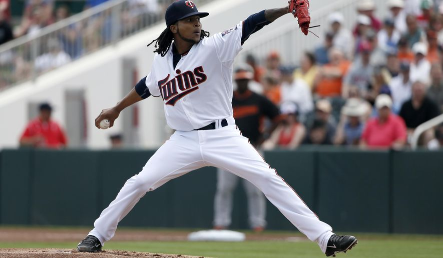 Minnesota Twins' Ervin Santana works against the Baltimore Orioles in the first inning of a spring training baseball game in Fort Myers, Fla., Sunday, March 8, 2015. (AP Photo/Tony Gutierrez)