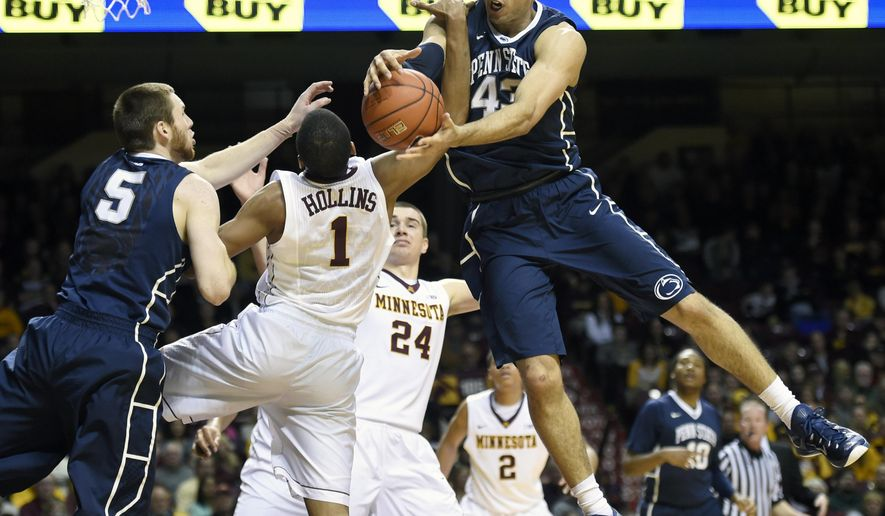 Penn State forward Ross Travis (43) rebounds over Minnesota guard Andre Hollins (1) and Penn State forward Donovon Jack (5) during the first half of an NCAA college basketball game Sunday, March 8, 2015, in Minneapolis. (AP Photo/Hannah Foslien)