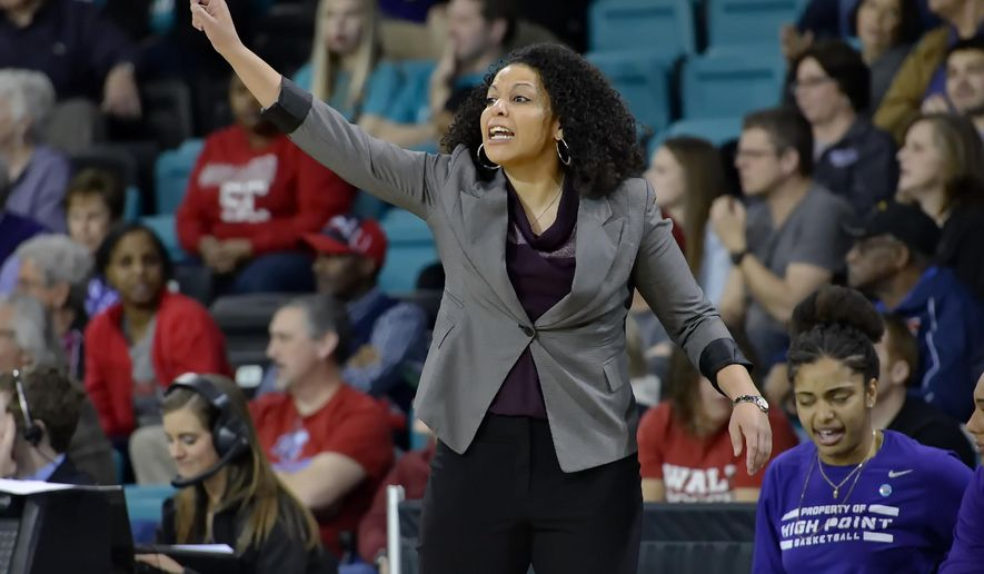 High Point coach DeUnna Hendrix reacts to a play during the first half of the Big South Conference Championship NCAA college basketball game against Liberty, Sunday, March 8, 2015, in Conway, S.C. (AP Photo/Richard Shiro)