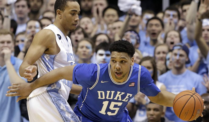 North Carolina's Brice Johnson, left, guards Duke's Jahlil Okafor (15) during the first half of an NCAA college basketball game Saturday, March 7, 2015 in Chapel Hill, N.C. (AP Photo/Gerry Broome)