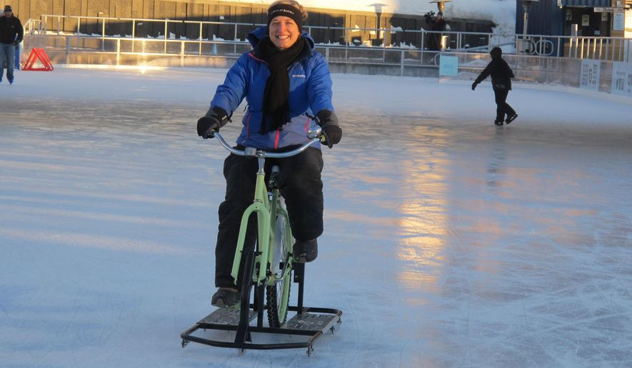 In a Feb. 25, 2015 photo, Lisa Florczak, founder of Ice Bikes of Buffalo, rides one of her inventions at the Ice at Canalside in Buffalo, N.Y., Feb. 25, 2015. Since the rental bikes debuted in December, Florczak has gotten inquiries from other cold-weather cities interested in rolling them out next year. (AP Photo/Carolyn Thompson)