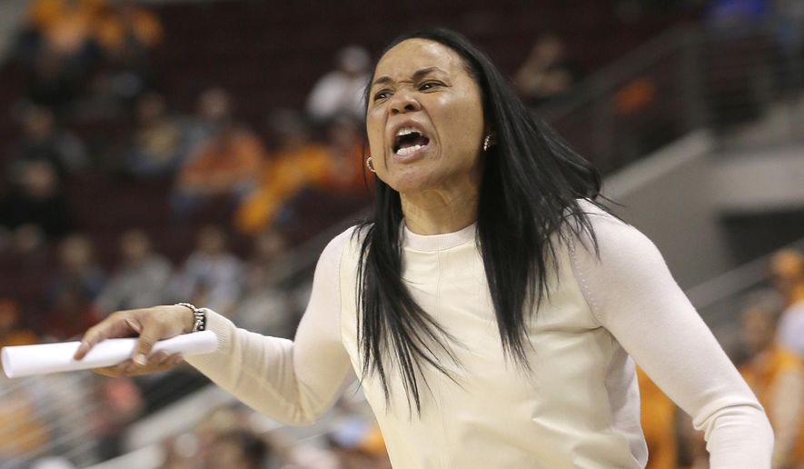 South Carolina coach Dawn Staley shouts in the first half of the NCAA college basketball game final of the Southeastern Conference tournament against Tennessee in North Little Rock, Ark., Sunday, March 8, 2015. (AP Photo/Danny Johnston)