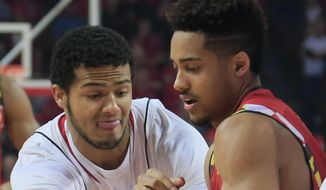 Nebraska guard Shavon Shields, left, and Maryland's Melo Trimble (2) struggle for the ball during the first half of an NCAA college basketball game in Lincoln, Neb., Sunday, March 8, 2015. (AP Photo/Nati Harnik)
