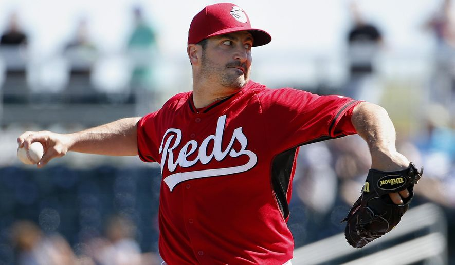 Cincinnati Reds' Jason Marquis throws a pitch against the Seattle Mariners during the first inning of a spring training baseball game Sunday, March 8, 2015, in Goodyear, Ariz. (AP Photo/Ross D. Franklin)