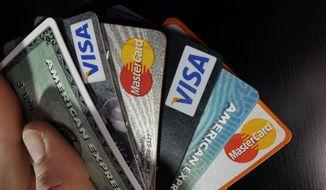 Consumer credit cards. (AP Photo/Elise Amendola, File)