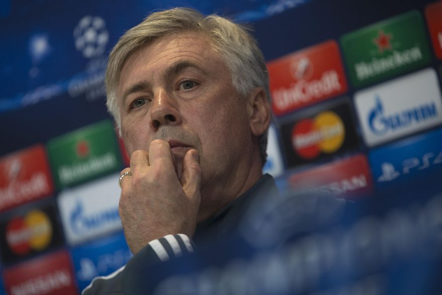 Real Madrid's coach Carlo Ancelotti waits for a press conference to start on Monday, March 9, 2015 in Madrid, Spain. Real Madrid will play Schalke 04 Tuesday in a round of 16 second leg Champions League soccer match. (AP Photo/Paul White)