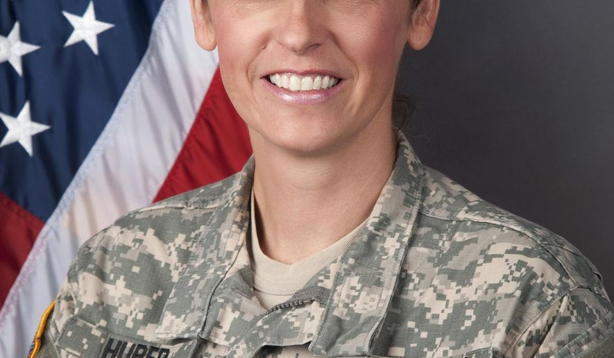 This undated photo provided by the North Dakota National Guard shows Col. Jackie Huber, of Bismarck, N.D., who assumed command of the North Dakota National Guard's 164th Regiment Regional Training Institute Saturday, March 7, 2015, at Camp Grafton near Devils Lake, N.D. Huber takes over for Col. Leo Ryan, who is taking command of the Fargo-based 141st Maneuver Enhancement Brigade next month. (AP Photo/Courtesy of the North Dakota National Guard)