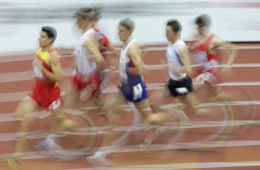 FILE - In this March 7, 2015 file photo taken with slow shutter speed Britain's Charlie Grice, center, competes in a men's 1500m heat at the European Athletics Indoor Championships in Prague, Czech Republic. (AP Photo/Petr David Josek, file)