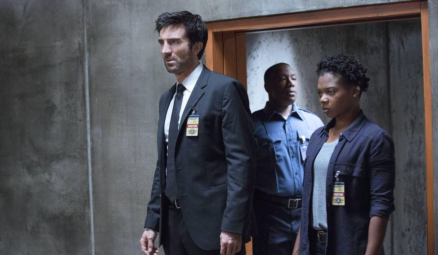 """This image provided by Sony Pictures Television shows Sharlto Copley, left, and Susan Heyward in a scene from """"Powers."""" The series' 10-episode first season is the latest blossoming of scripted TV fare from unexpected sources. Home base for """"Powers"""" is the PlayStation network. This means starting Tuesday, March 10, 2015, the series will be free to PlayStation subscribers, and the first episode free to anyone, for streaming through the PlayStation Store web site (a PlayStation console is not required). Subsequent episodes will be available for purchase by non-subscribers. (AP Photo/Sony Pictures Television)"""
