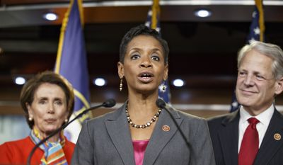 Rep. Donna Edwards, D-Md., is flanked by House Minority Leader Nancy Pelosi, D-Calif., left, and Rep. Steve Israel, D-N.Y., right, speaks to reporters after Pelosi announced that Edwards will become co-chair of the House Democrats' Steering and Policy Committee with Rep. Rosa DeLauro, D-Conn., during a news conference at the Capitol in Washington, Monday, Nov. 17, 2014.  (AP Photo/J. Scott Applewhite)