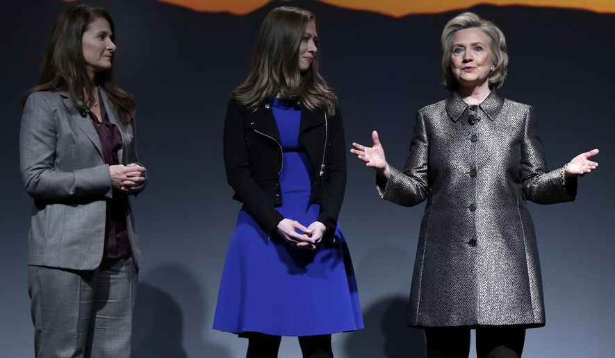 """Melinda Gates, left, Chelsea Clinton, center, and Hillary Rodham Clinton participate in the """"No Celings: The Full Participation Project,"""" in New York, Monday, March 9, 2015. (AP Photo/Richard Drew)"""