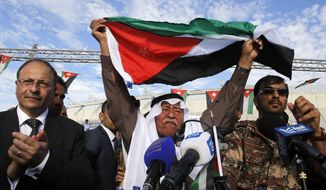 Jordanians chant slogans to show their support for the government's campaign against terror during a rally in Amman, Jordan. (Associated Press)