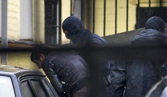 Police escorts Zaur Dadaev, believed to be one of five suspects in the killing of Boris Nemtsov, into a court room in Moscow, Russia, March 8, 2015. (AP Photo/Ivan Sekretarev) ** FILE **