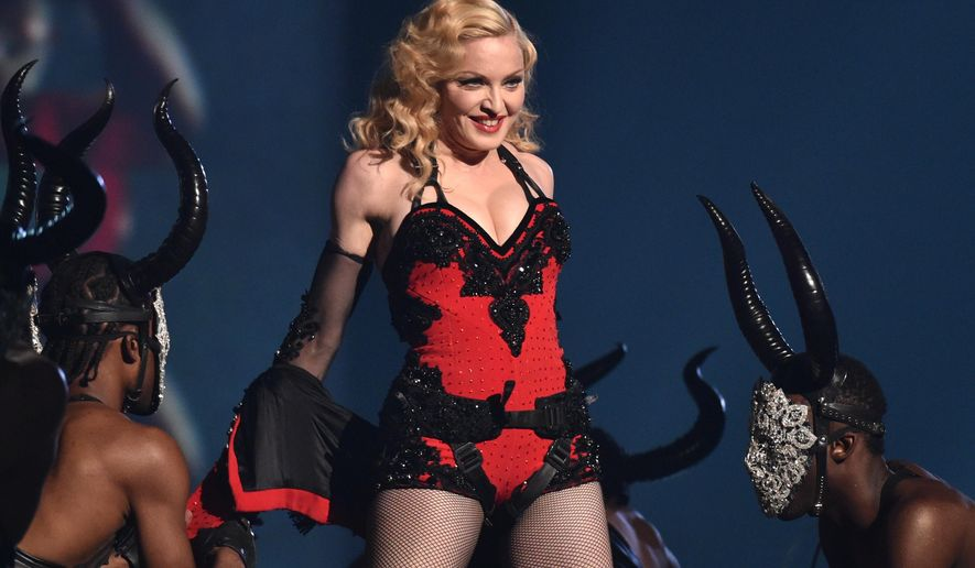 This Feb. 8, 2015 file photo shows Madonna performing at the 57th annual Grammy Awards in Los Angeles. Madonna, Rihanna and Sam Smith will perform at the second annual iHeartRadio Music Awards on March 29, 2015, at the Shrine Auditorium in Los Angeles, iHeartMedia announced Monday, March 9, 2015.  (Photo by John Shearer/Invision/AP)