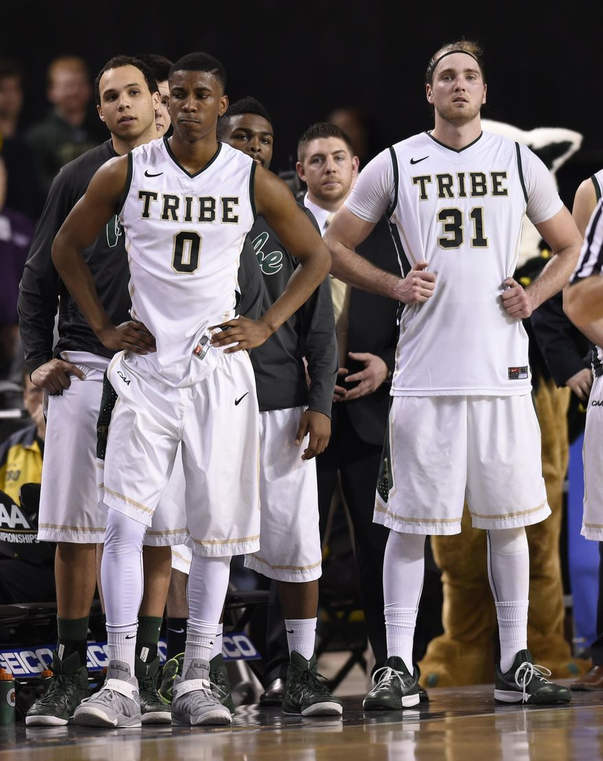 William and Mary's Daniel Dixon, (0), and Sean Sheldon watch in the final seconds of an NCAA college championship game against Northeastern during the Colonial Athletic Association tournament, Monday, March 9, 2015, in Baltimore.(AP Photo/Gail Burton)