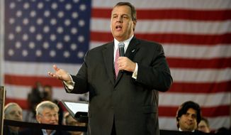 """Although he's down in presidential polls, New Jersey Gov. Chris Christie told town hall meeting Tuesday that he's """"still standing."""" Using the event to cement his no nonsense image, Mr. Christie continued to tout his budget plans for the upcoming fiscal year. (Associated Press)"""