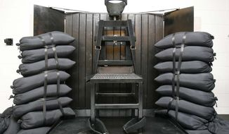 FILE - This June 18, 2010, file photo shows the firing squad execution chamber at the Utah State Prison in Draper, Utah. Utah's Gov. Gary Herbert will not say if he'll sign a bill to bring back the firing squad but does say the method would give Utah a backup execution method. Herbert's spokesman Marty Carpenter issued a statement about the bill Tuesday in response to questions from reporters. Utah's Senate is set to cast a final vote on the bill this week. It would call for a firing squad if lethal injection drugs cannot be obtained 30 days before an execution. (AP Photo/Trent Nelson, Pool, File)