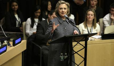 Hillary Rodham Clinton delivers her remarks in the ECOSOC chamber of the United Nations, during the annual Women's Empowerment Principles event, Tuesday, March 10, 2015. (AP Photo/Richard Drew)