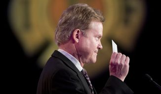 Former Virginia Sen. Jim Webb holds up his union card as he speaks at the International Association of Firefighters (IAFF) Legislative Conference and Presidential Forum in Washington, Tuesday, March 10, 2015. (AP Photo/Pablo Martinez Monsivais)