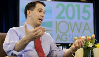 Wisconsin Gov. Scott Walker speaks during the Iowa Agriculture Summit in Des Moines, Iowa, in this March 7, 2015, file photo. (AP Photo/Charlie Neibergall) ** FILE **