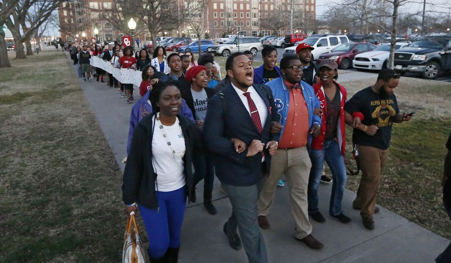 University of Oklahoma students march to the now closed University of Oklahoma's Sigma Alpha Epsilon fraternity house during a rally in Norman, Okla., Tuesday, March 10, 2015. The university's president expelled two students Tuesday after he said they were identified as leaders of a racist chant captured on video during a fraternity event. (AP Photo/Sue Ogrocki)