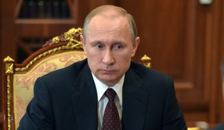 Russian President Vladimir Putin listens during a meeting at the Kremlin, in Moscow, Russia, Tuesday, March 10, 2015.(AP Photo/RIA Novosti, Alexei Druzhinin, Presidential Press Service)