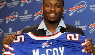 Buffalo Bills running back LeSean McCoy holds his jersey after a press conference in Orchard Park, N.Y., Tuesday, March 10, 2015. McCoy is guaranteed to make $26.5 million, including $16 million this season, making him the NFL's highest paid running back,(AP Photo/Gary Wiepert)
