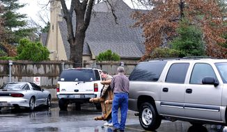 Parents helped students move their furniture out of the Sigma Alpha Epsilon house at the University of Oklahoma on Monday, March. 9, 2015, in Norman, Okla. President David Boren of the University of Oklahoma severed the school's ties with a national fraternity on Monday and ordered that its on-campus house be shuttered after several members took part in a racist chant caught in an online video. (AP Photo/Nick Oxford)