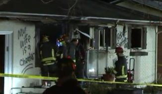 """A Colorado home that exploded and caught fire Tuesday morning had the words """"My wife is a cheater"""" spray-painted on one of the outside walls. (Fox 31 Denver)"""