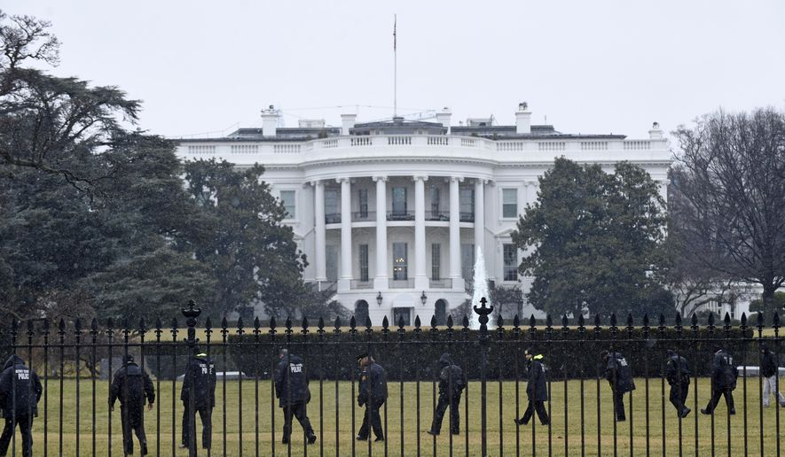 In this Jan. 26, 2015, file photo, Secret Service officers search the south grounds of the White House in Washington after an unmanned aerial drone was found on the White House grounds during the middle of the night. (AP Photo/Susan Walsh, File)