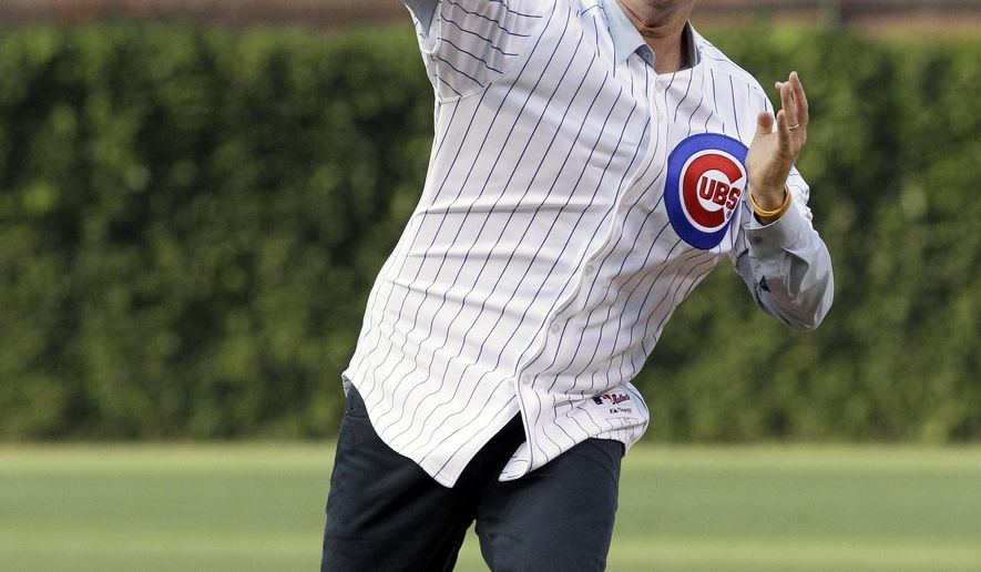 "FILE - In this July 18, 2012, file photo, comedian Will Ferrell throws out the ceremonial first pitch before a baseball game between the Miami Marlins and the Chicago Cubs in Chicago. Ferrell will appear in at least two Arizona spring training games on Thursday, March 12, 2015. The Chicago White Sox confirmed the star of ""Anchorman"" and many other movies will appear in their game against the San Francisco Giants in Glendale and the San Diego Padres say he will play in their game against the Los Angeles Dodgers in Peoria. (AP Photo/Nam Y. Huh, File)"