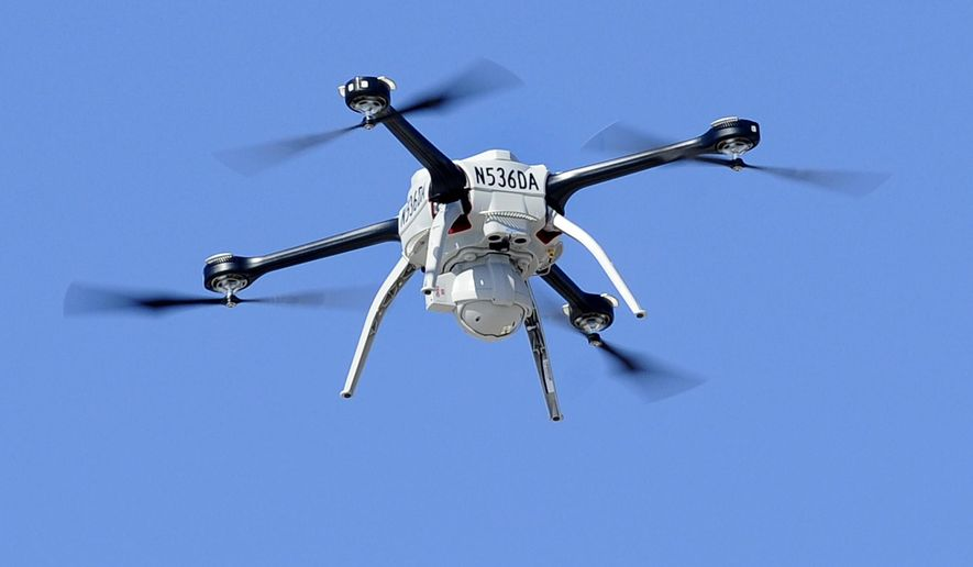 A drone piloted by Michigan State Police Pilot  Sgt. Matt Rogers  lifts off during a demonstration near  the State Police  Training Academy outside Lansing, Mich., Wednesday March 11, 2015.  The Federal Aviation Administration just gave the state police the ok to use drones for search and rescue and crime scene and accident scene investigations. (AP Photo/The Lansing State Journal, Rod Sanford)