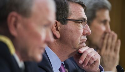 "UNITED STATES - MARCH 11: From left, Chairman of the Joint Chiefs of Staff Gen. Martin Dempsey, Secretary of Defense Ashton Carter, and Secretary of State John Kerry, appear before a Senate Foreign Relations Committee hearing in Dirksen Building titled ""The President's Request for Authorization to Use Force Against ISIS: Military and Diplomatic Efforts,"" March 11, 2015. (Photo By Tom Williams/CQ Roll Call) (CQ Roll Call via AP Images)"