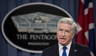 British Defense Secretary Michael Fallon, speaks during a news conference with Defense Secretary Ash Carter, Wednesday, March 11, 2015, following their meeting at the Pentagon.  (AP Photo/Manuel Balce Ceneta) ** FILE **