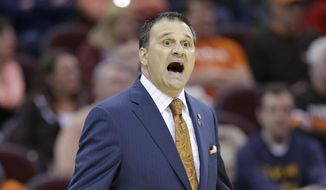 Bowling Green head coach Chris Jans yells to players during the first half of an NCAA college basketball game in the second round of the Mid-American Conference tournament Wednesday, March 11, 2015, in Cleveland. Eastern Michigan defeated Bowling Green 73-67. (AP Photo/Tony Dejak)