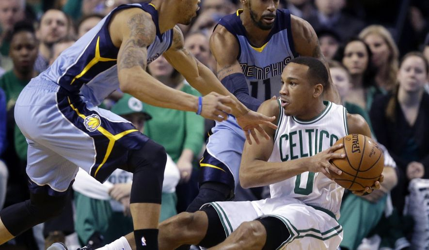 Boston Celtics guard Avery Bradley (0) looks to pass the ball as he falls to the floor against the defense of Memphis Grizzlies guards Courtney Lee, left, and Mike Conley (11) during the first half of an NBA basketball game in Boston, Wednesday, March 11, 2015. (AP Photo/Elise Amendola)