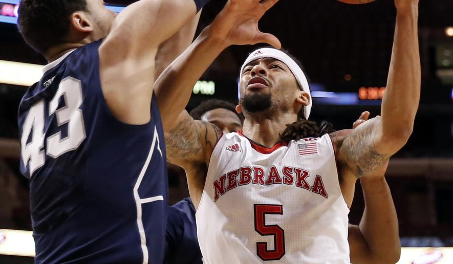 Nebraska's Terran Petteway (5) goes up for a shot against Penn State's Ross Travis (43) during the first half of an NCAA college basketball game in the first round of the Big Ten Conference tournament, Wednesday, March 11, 2015, in Chicago. (AP Photo/Charles Rex Arbogast)