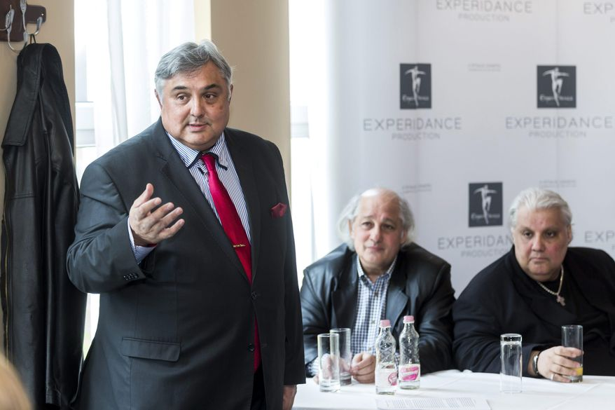 President of the Budapest Gypsy Symphony Orchestra Nandor Farkas Beke, left speaks as, from left, concert master Andras Suki and cimbalom soloist Oszkar Okros look on during a press conference in Budapest, Hungary, Wednesday, March 11, 2015. The orchestra says a temporary injunction has banned the producer of another large group of Gypsy musicians from copying their name. Beke said that the ruling by a court in Lyon, France, will be in place until the issue is conclusively settled in a lawsuit to be filed soon. (AP Photo/MTI, Balazs Mohai)