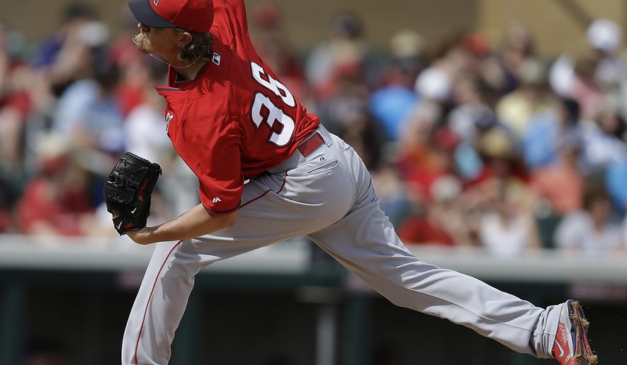 Los Angeles Angels' Jered Weaver throws against the Arizona Diamondbacks in the first inning of a spring training exhibition baseball game Wednesday, March 11, 2015, in Scottsdale, Ariz. (AP Photo/Ben Margot)
