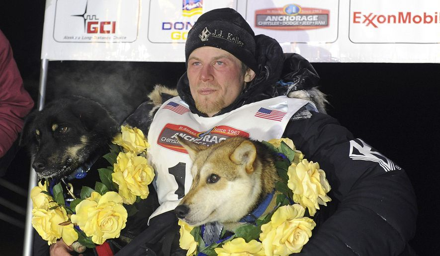 File - In this March 11, 2014 file photo, Dallas Seavey sits under the burled arch in Nome, Alaska after winning the 2014 Iditarod Trail Sled Dog Race. (AP Photo/The Anchorage Daily News, Bob Hallinen, File)  LOCAL TV OUT (KTUU-TV, KTVA-TV) LOCAL PRINT OUT (THE ANCHORAGE PRESS, THE ALASKA DISPATCH)